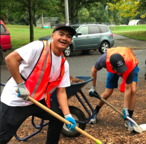 UP Students Spreading Mulch at Pier Park