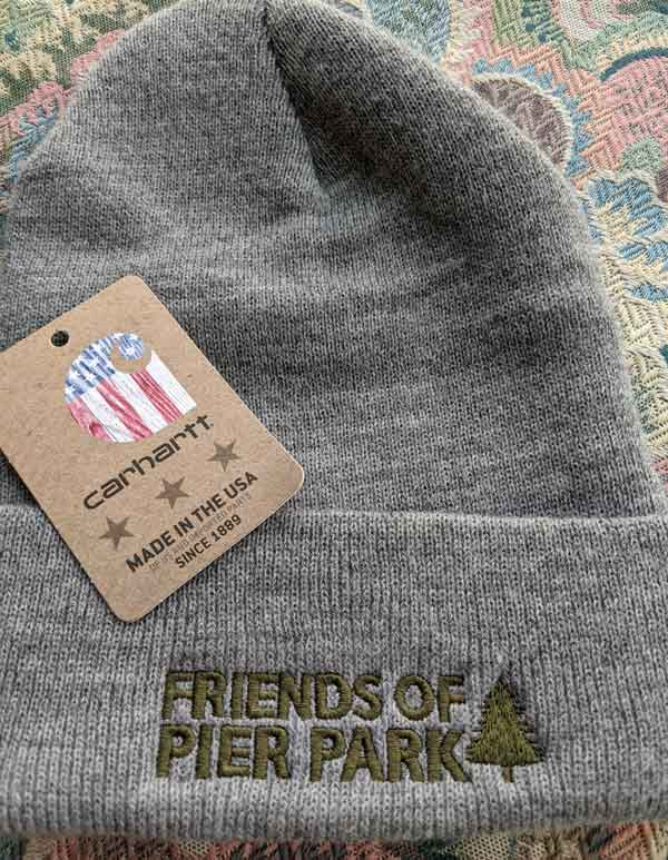 Carhartt tag with Friends of Pier Park design on beanie