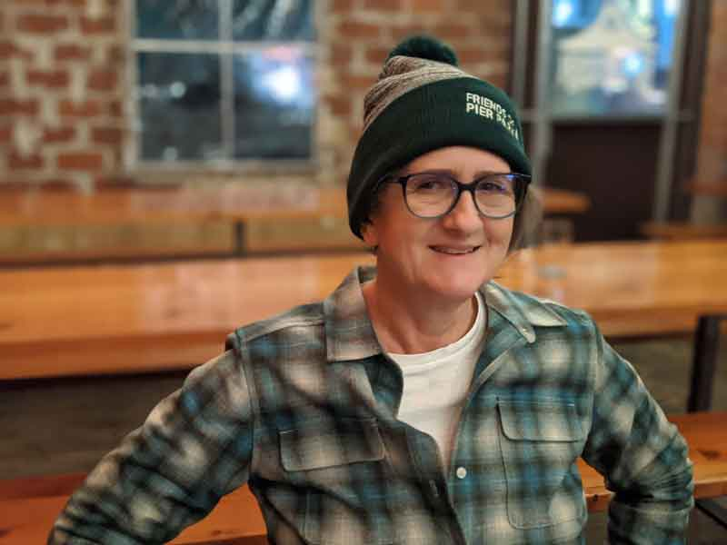 Friends of Pier Park beanie with pom worn by Mary Ann Aschenbrenner