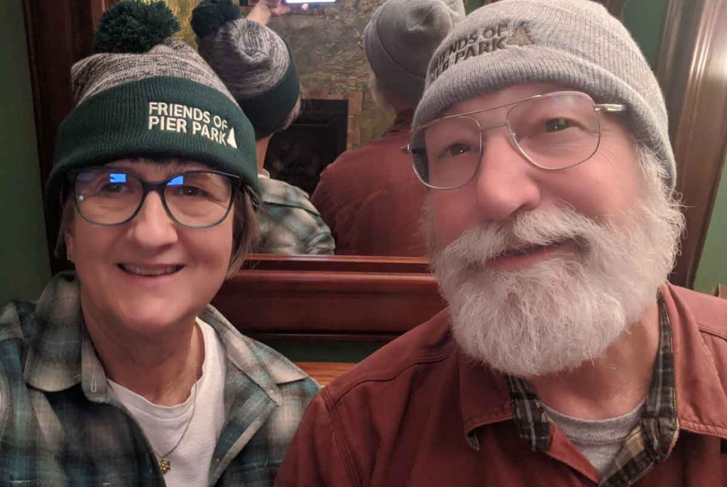 Mary Ann and John in Friends of Pier Park beanies