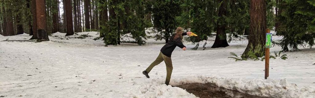disc golfer in the snow in Pier Park